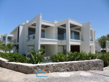 2+1 apartment for sale in a seafront complex with private beach