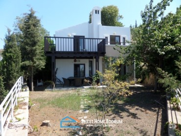 Gumusluk, villa for sale with seaview and private garden