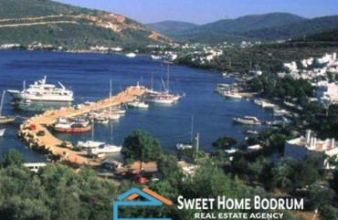SEAFRONT LAND PLOT IN TORBA WITH %15+15=30 TOURISM BUILDING PERMISSION