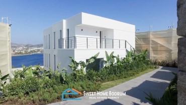 Yalıkavak'ta denize sıfır özel bir site içinde 4+1 dubleks villa