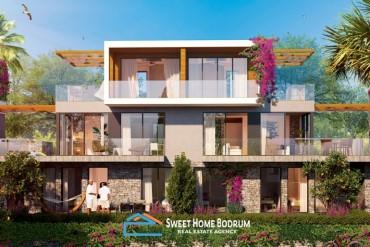 Adabükü'nde satılık, deniz manzaralı, denize sıfır site içinde 4+1 villalar